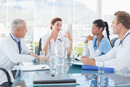 conversation: Team of smiling doctors having a meeting in the meeting room