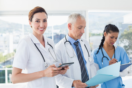 a doctor: Doctors working together on patients file in medical office