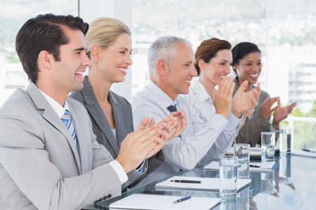 applauding: Business team applauding during conference in the office