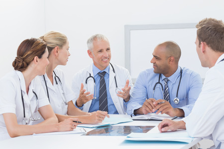 medical doctors: Team of doctors having a meeting in medical office