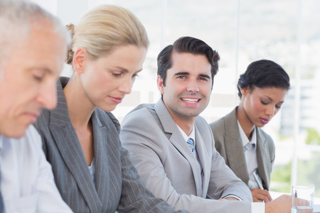 mature business man: Business team taking notes during conference in the office Stock Photo