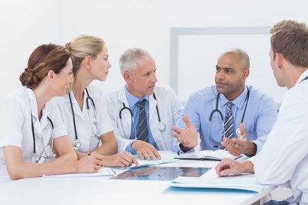 happy work: Team of doctors having a meeting in medical office