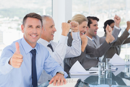 Business team celebrating a good job in the office Stock Photo - 42519073