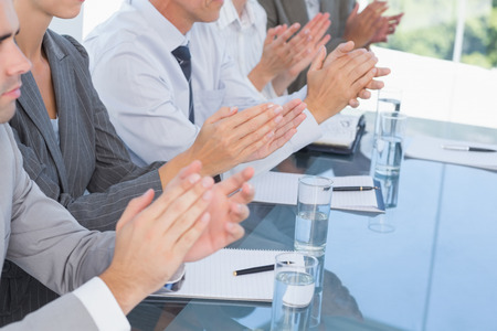 applause: Business team applauding during conference in the office