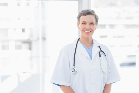 doctor office: Smiling female doctor in medical office
