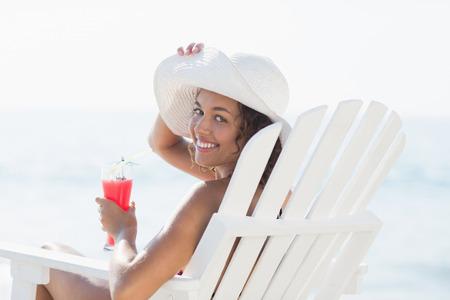 summer vacation bikini: pretty brunette in swimsuit at the beach