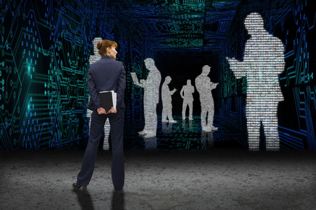 data matrix: Businesswoman looking against business people in data matrix Stock Photo