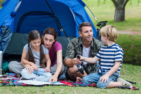 summer activities: Happy family in the park together on a sunny day Stock Photo