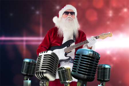 Santa Claus plays guitar with sunglasses against light design on pink background
