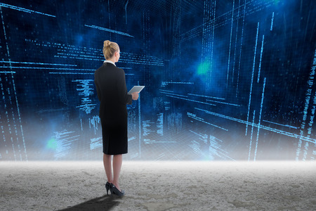 data matrix: Businesswoman holding new tablet against glowing blue data matrix