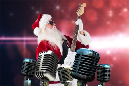 lean back: Santa playing electric guitar against light design on pink background