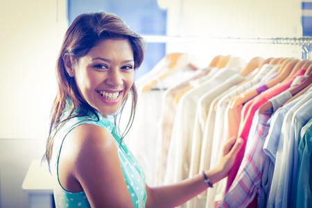 happy shopper: Happy shopper smiling at camera in boutique