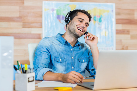 travel agent: Handsome travel agent speaking with customer in the office Stock Photo