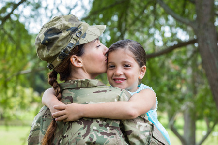 veterans: Soldier reunited with her daughter on a sunny day
