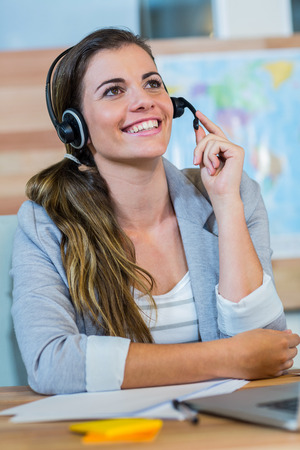 travel agent: Pretty travel agent speaking to customer in the office