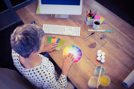 interior designer: Interior designer working at desk in creative office Stock Photo