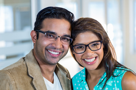 mid adult couples: Portrait of smiling partners posing together in the office