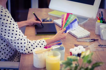 Interior designer working at desk in creative office Stockfoto