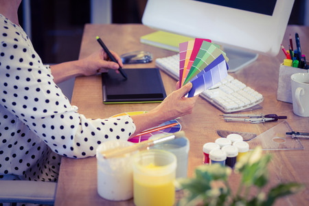 Interior designer working at desk in creative office Banco de Imagens