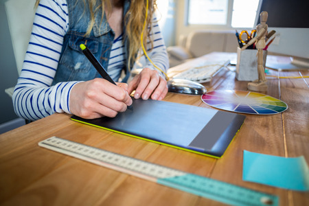 colour wheel: Designer working with colour wheel and digitizer in the office