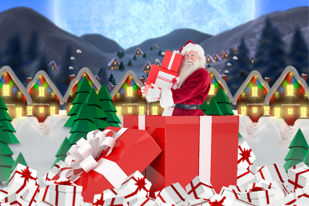 quaint: Santa standing in large gift against quaint town with bright moon