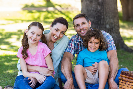 multiracial family: Happy family on a picnic in the park on a sunny day