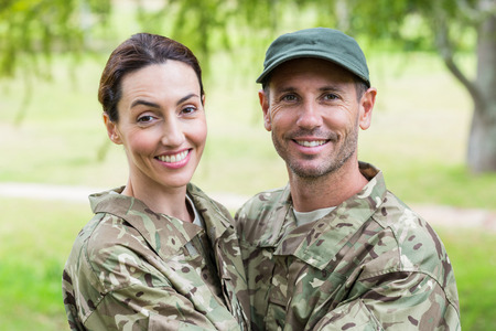 army soldier: Army parents reunited on a sunny day Stock Photo