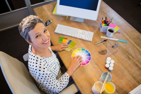 colour chart: Casual businesswoman working with colour chart in the office