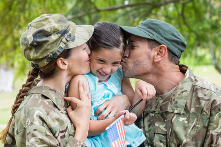 Army parents reunited with their daughter on a sunny day 写真素材