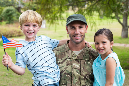 soldiers: Handsome soldier reunited with family on a sunny day