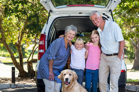 cute guy: Grandparents going on road trip with grandchildren on a sunny day Stock Photo