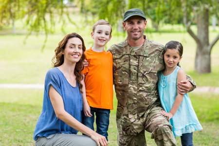 veteran: Handsome soldier reunited with family on a sunny day