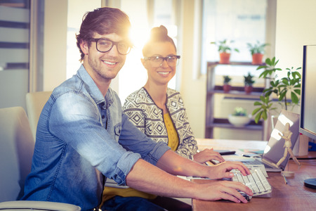 graphic designing: Happy designers working together in creative office