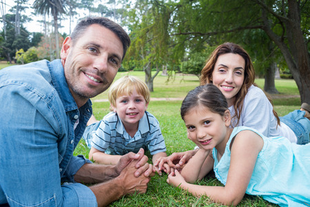 guy portrait: Happy family in the park together on a sunny day Stock Photo