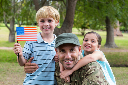 military man: Handsome soldier reunited with family on a sunny day