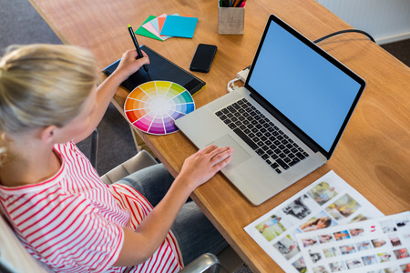 digitizer: Designer working with colour wheel and digitizer in the office