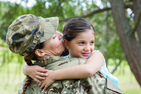 army uniform: Soldier reunited with her daughter on a sunny day