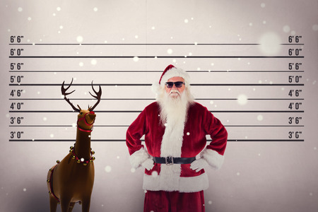 mug shot: Santa claus wears black sunglasses against mug shot background
