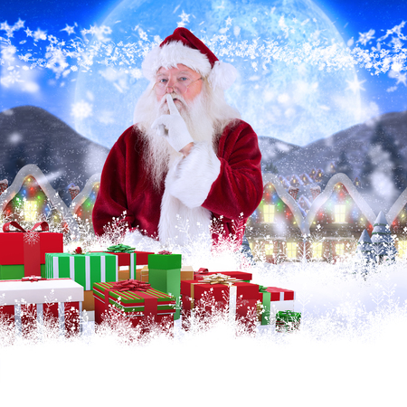 quaint: Santa asking for quiet to camera against quaint town with bright moon