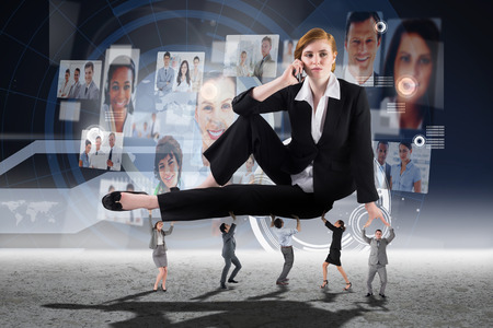 business profiles: Business people supporting boss against interface with business profiles Stock Photo