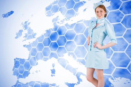 hotesse de l air: Pretty air hostess with hand on hip against background with europa map