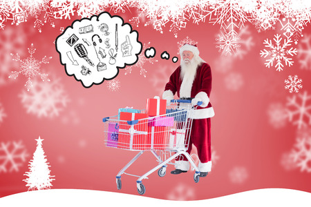 pushes: Santa pushes a shopping cart with presents against fir tree silhouette over red