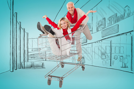 messing: Happy festive couple messing in trolley against blue vignette