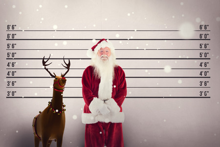 father in law: Jolly santa smiling at camera against mug shot background Stock Photo