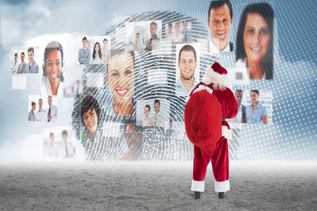 business profiles: Santa carrying sack of gifts against business profiles with fingerprint Stock Photo