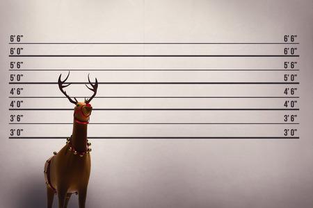 lineup: Digital santas reindeer with bells against mug shot background