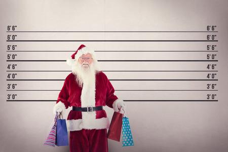 lineup: Santa carries some Christmas bags against mug shot background