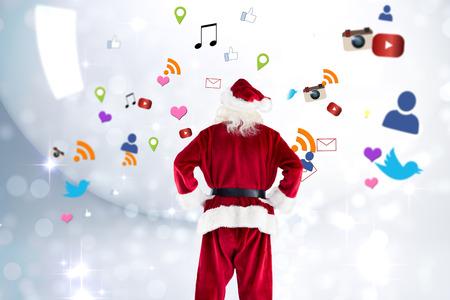 twinkling: Santa Claus against lights twinkling in room