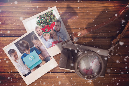 christmas memories: Composite image of christmas memories  against instant photos on wooden floor Stock Photo