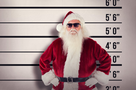 father in law: Santa Claus wears black sunglasses  against mug shot background